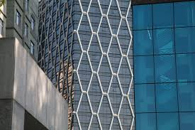 tall buildings black glass curtain wall sunshine
