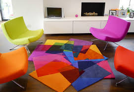 bright multi colored rug with matching chair colors