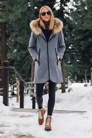 blonde woman wearing grey wool coat with faux fur hood spanx black faux leather leggings marc