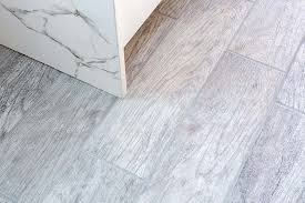 wood look tile flooring in a newly remodeled kitchen