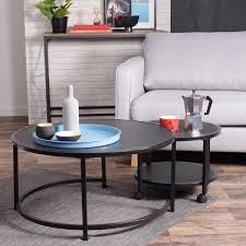 The legs intersect on the floor in the center of the table. Furniturer Neka 2 Piece 34 In Black Medium Round Wood Coffee Table Set With Casters Neka Bk Lmkz The Home Depot