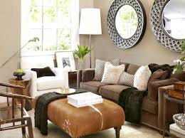 putting a large plant behind the chair defines it and also softens the space big furniture small living room