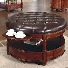 interior large round leather coffee table ottoman design two ceramics white drinkware carpet contemporary simple
