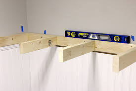 tutorial on how to build diy floating shelves via jen woodhouse