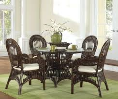 awesome dining room with round glass table also black wicker chairs design plus size