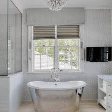 white and blue bathroom with tv