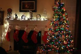 mantel lighting. dim christmas mantel decoration featuring white lighting fixtures and red stockings colorful i