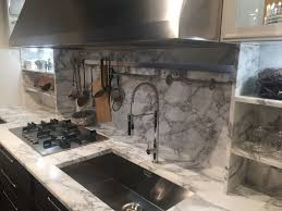 ... Marble backsplash for kitchen with stainless steel hanging pots