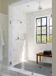 view in gallery marble tile shower with a patterned floor