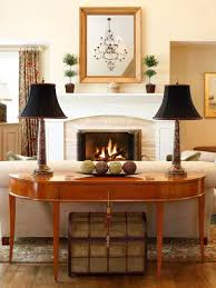 sofa table ideas. Inspiration For A Timeless Medium Tone Wood Floor Family Room Remodel In Philadelphia With Beige Walls Sofa Table Ideas B
