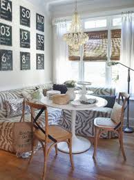 luxurious chandelier over unique breakfast nook design and natural window shade large size