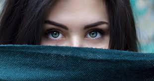 stock photo of a woman s eyes with her face covered by a scarf