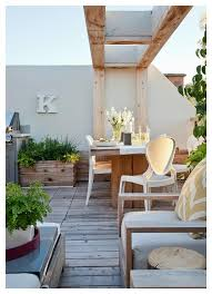 Teak Outdoor Dining Table with Modern White Chairs Transitional