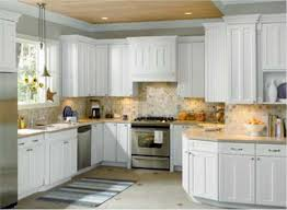 image of white kitchen cabinets with black countertops