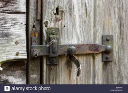 latch and lock on old shed door stock image