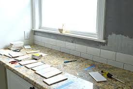 kitchen reno update subway tile backsplash tile going up fieldcourt com