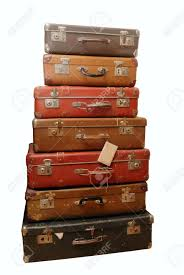 Pile of battered old suitcases and trunks in poor condition Stock Photo -  8896185