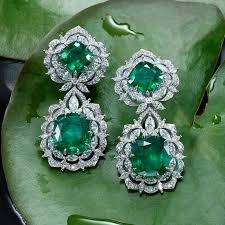 repost unveiled at diser our incredible new earrings featuring responsibly sourced gemfields zambian emeralds
