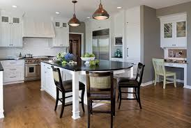 Is is another rounded island with seating from Houzz for your inspiration.