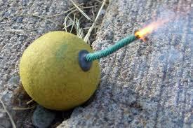 Smoke bomb with lit fuse