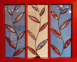 i paint the frames and insert new etched or stained glass panels the old frames take on a second life as a window frame for glass art