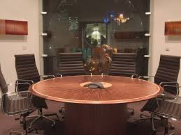 round boardroom tables in walnut veneer