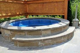 creative stone hot tub collection a round hot tub with a stone surround and a stone creative stone hot tub