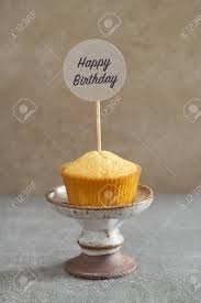 Homemade Vanilla Cupcake With A Handcrafted Birthday Cake Pick