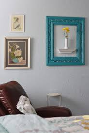 Cool frame idea...empty frame with shelf in it.