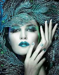 teal makeup and sequined feathers tjn