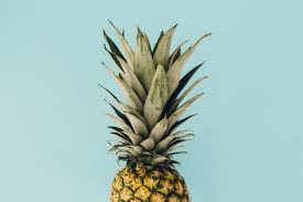 pineapple background. pineapple on blue background free photo