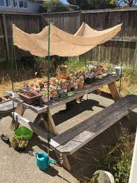 built a makeshift shade for my succulents after one of them got a slow sunburn burlap because home depot has zero shade cloth oh don t mind the wacky