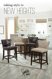 new heights furniture. take your style to new heights with our canidelli upholstered bar stools ashley furniture