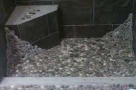 pebble shower floor with porcelain tile walls in hummelstown pa