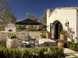 outdoor kitchen and dining areas outdoor cooking and eating areas form off the kitchen wing of this home s patio