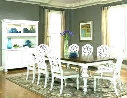 blue rattan chairs at round wood dining table cottage style and