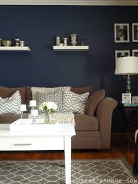 Navy Wall is painted in Valspar Signature Collection Mystified Have a navy  rug and tan walls now. Add an navy accent wall & navy pillows!