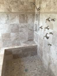 tiled walk in shower with wrap around bench using fiberglass shower pan construction