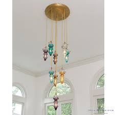 this indoor outdoor greenhouse chandelier by pottery barn is simply gorgeous we love the clean lines reminiscent of an actual greenhouse structure paired