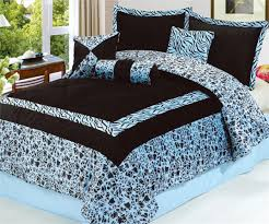 modern bedroom with long light brown curtains and king size safarina blue black comforter set