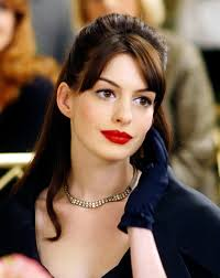 anne hathaway has used a bold red matching her pale plexion and simple eye makeup