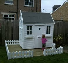 fencing and decked area childrens wooden garden playhouse