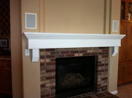 image of painting a wood fireplace mantel