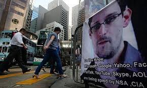 People walk past a banner supporting Edward Snowden in Hong Kong's business district. Photograph: Kin Cheung/AP - edward-Snowden-008