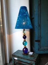 and speaking of lampshades we found a little that created a number of whimsical lampshades such as this one for a table lamp
