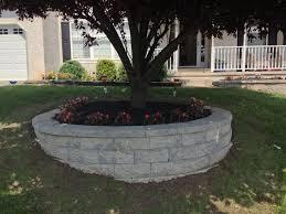 retaining wall custom flower bed in