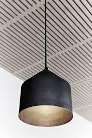 modern lighting pendant. great matte black pendant w metallic interior not to mention a cool ceiling modern lighting