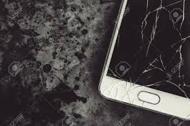 Smart Phone With Broken Screen On Dark ...