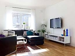 decorative ideas for living room apartments. Home Decor, Awesome Livingroom Decoration Wooden Floor Black Sofas Tv On The Wall White Decorative Ideas For Living Room Apartments R