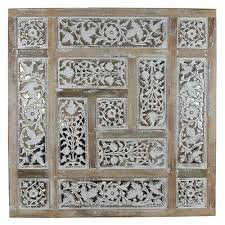 wood mirror with carved panel design in